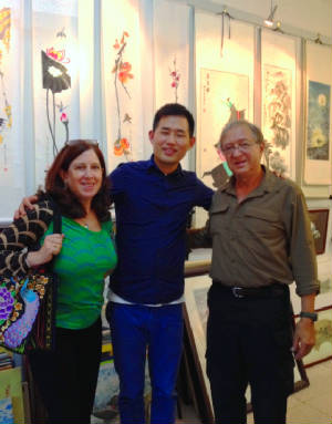 Beijing gallery with artist brother.JPG