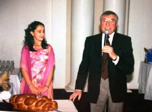 Uncle Gerard chanting the Motzi at Allegra's bat mitzvah.JPG