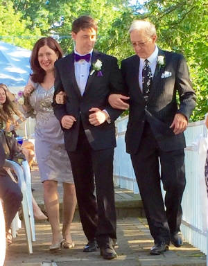 Walking Aidan down the aisle.jpg